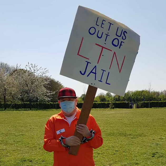 One protestor dress in an orange jump suit to make his point. Picture: Mike Hughes